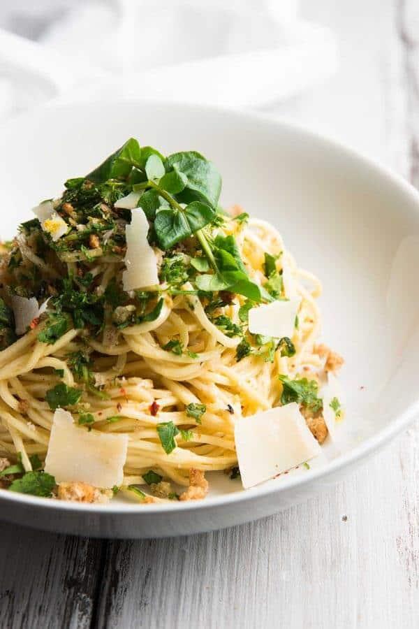 garlic butter pasta on white plate