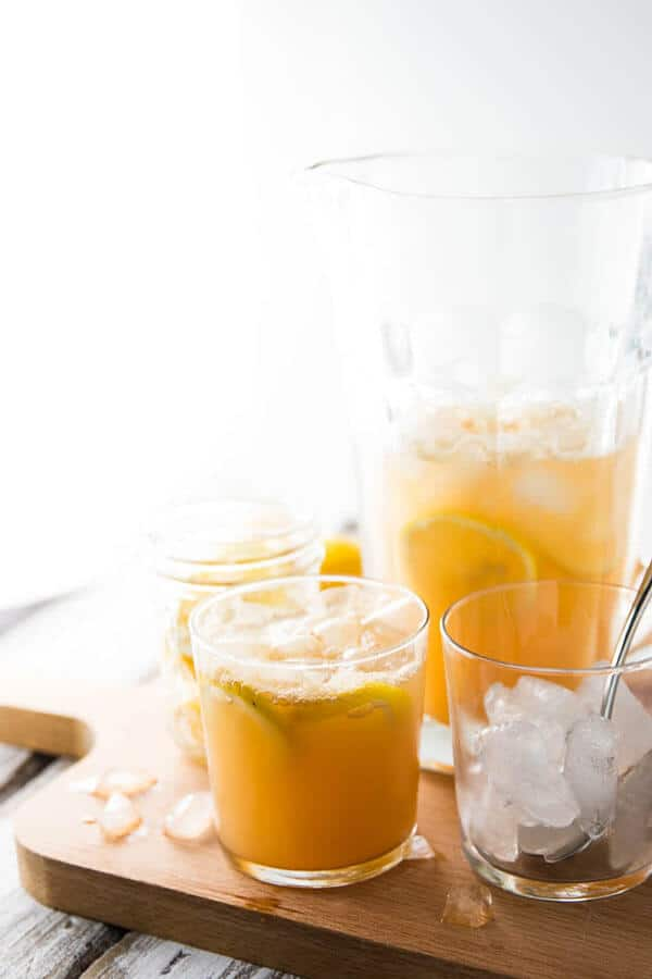 Spiced ginger lemonade in a pitcher with glasses