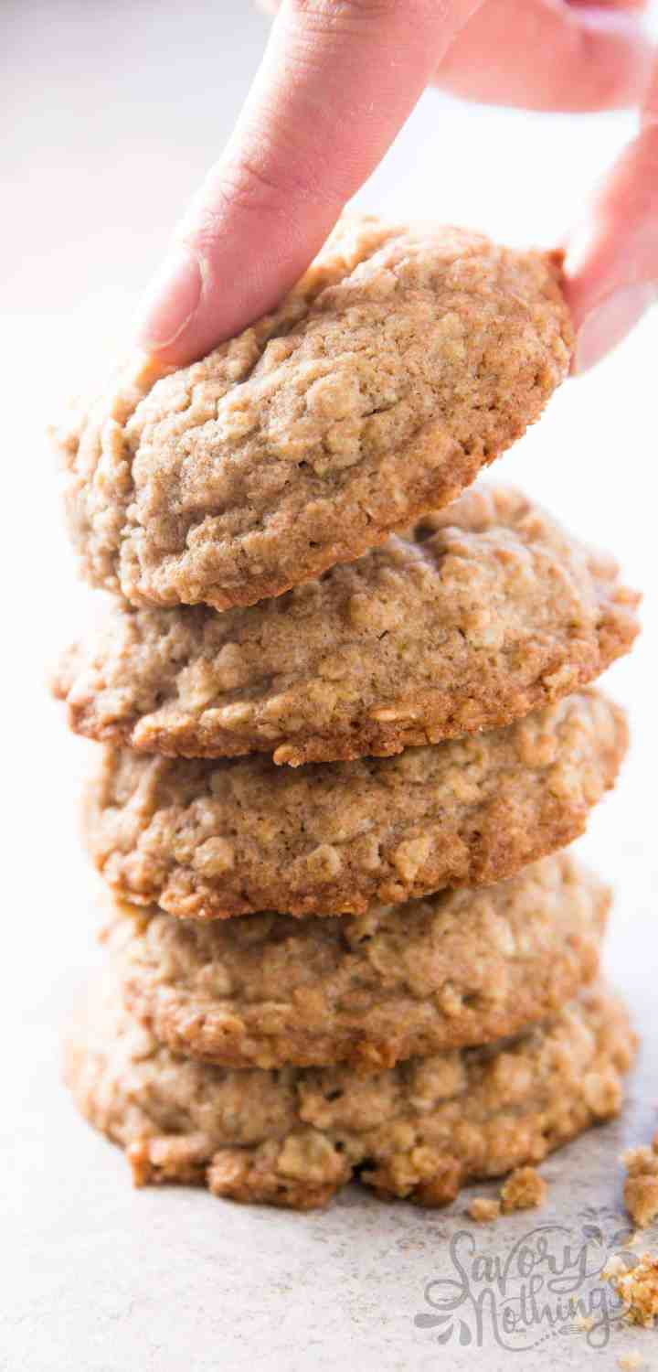 female hand taking an oatmeal cookie   from a stack