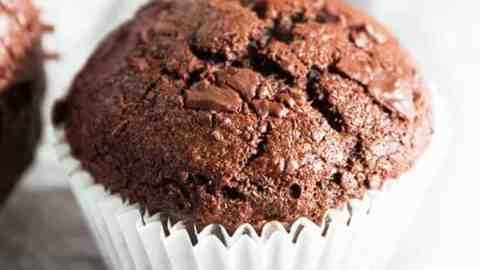 chocolate banana muffin on light surface