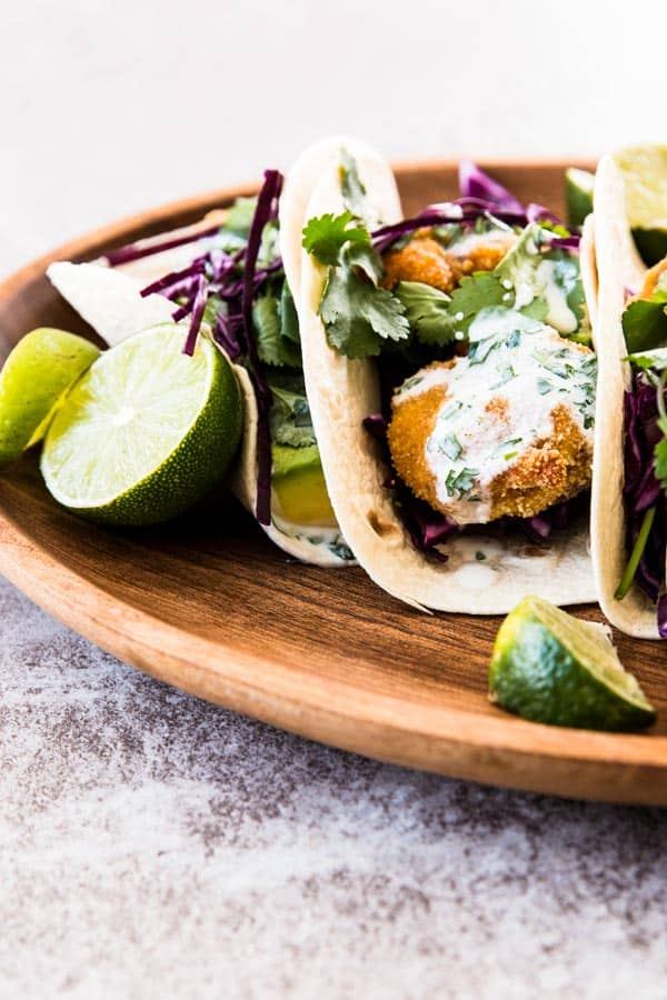 Crispy Oven Fried Shrimp Tacos with Cilantro Lime Salsa is an easy and healthy Mexican dinner recipe. Make them tonight!