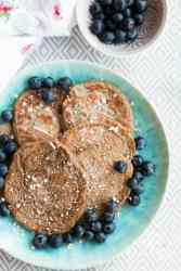 overhead view on blue plate with healthy pancakes on it
