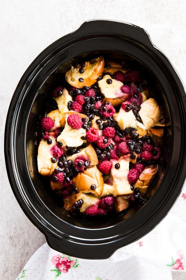This Crockpot Raspberry Chocolate Chip French Toast Casserole is easy to make with just a handful of ingredients. Perfect for Mother's Day!