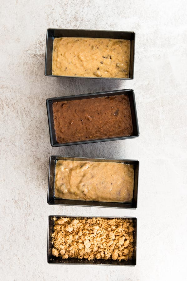 top down view on four loaf pans with banana bread batter