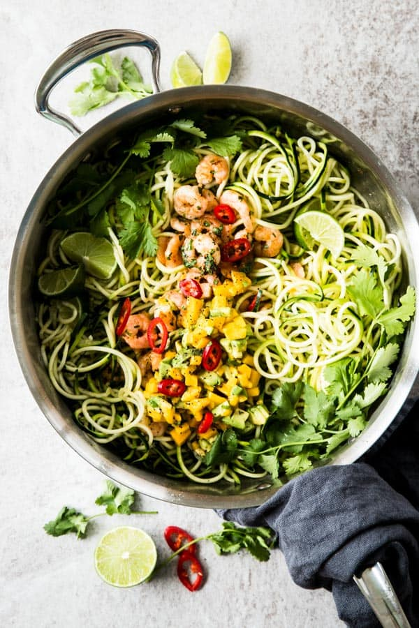 Zucchini Noodles with Cilantro Lime Shrimp and Avocado Mango Salsa: A simple and delicious low carb meal for the whole family! The fruity salsa is SO good, and 100% kid-approved.