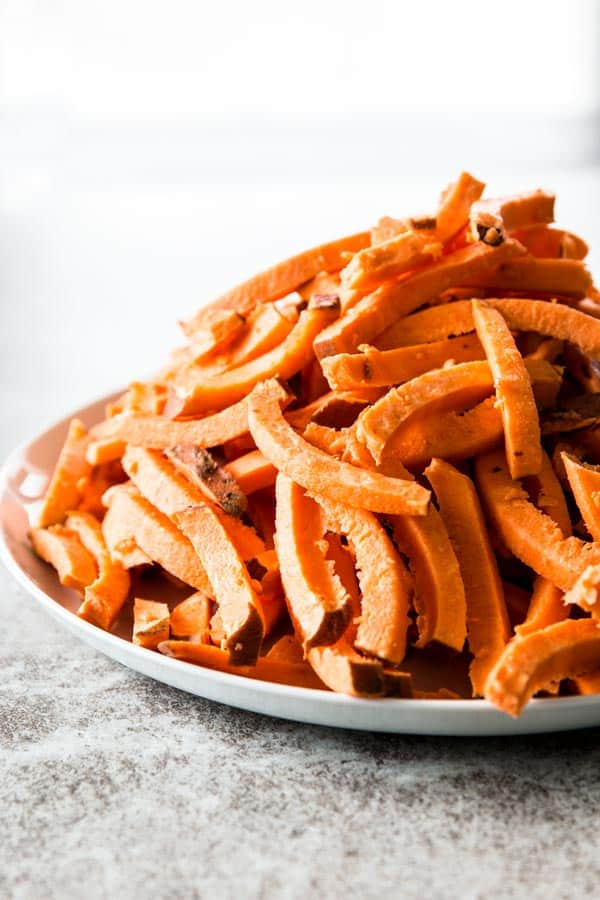 You only need three ingredients to make amazing Mexican sweet potato fries! The dip is super easy to whip up in your food processor, too.
