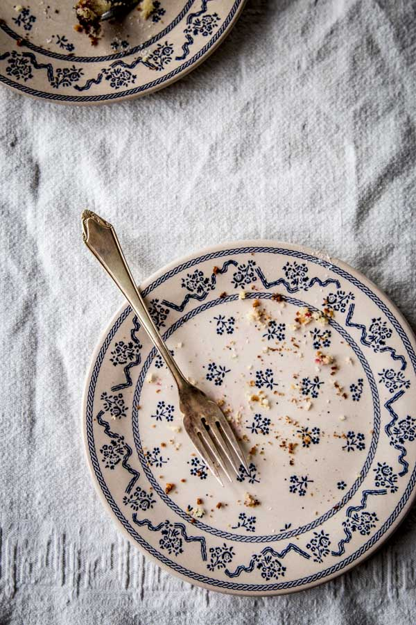 Empty Laura Ashley plates after eating raspberry yogurt cake.