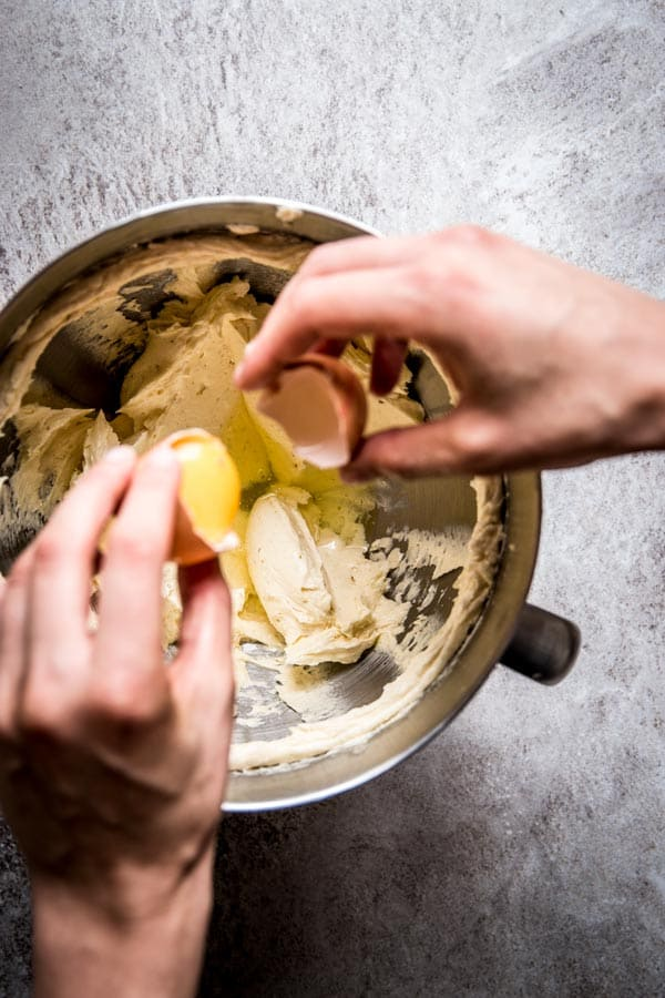 Adding egg to cake batter for streusel coffee cake. Beautiful food photography with motion.