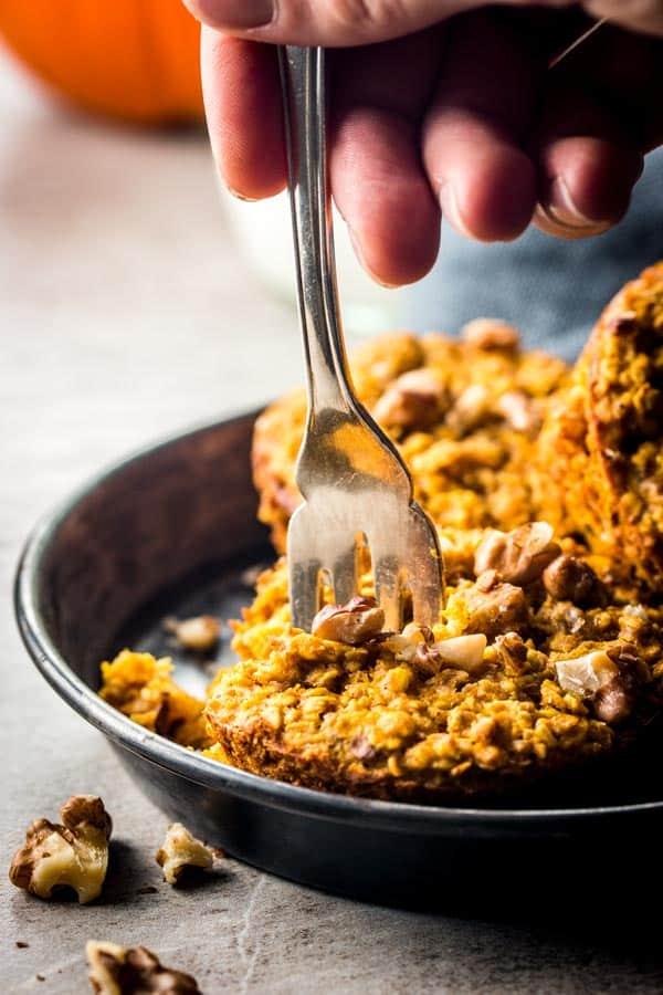 fork digging into pumpkin baked oatmeal