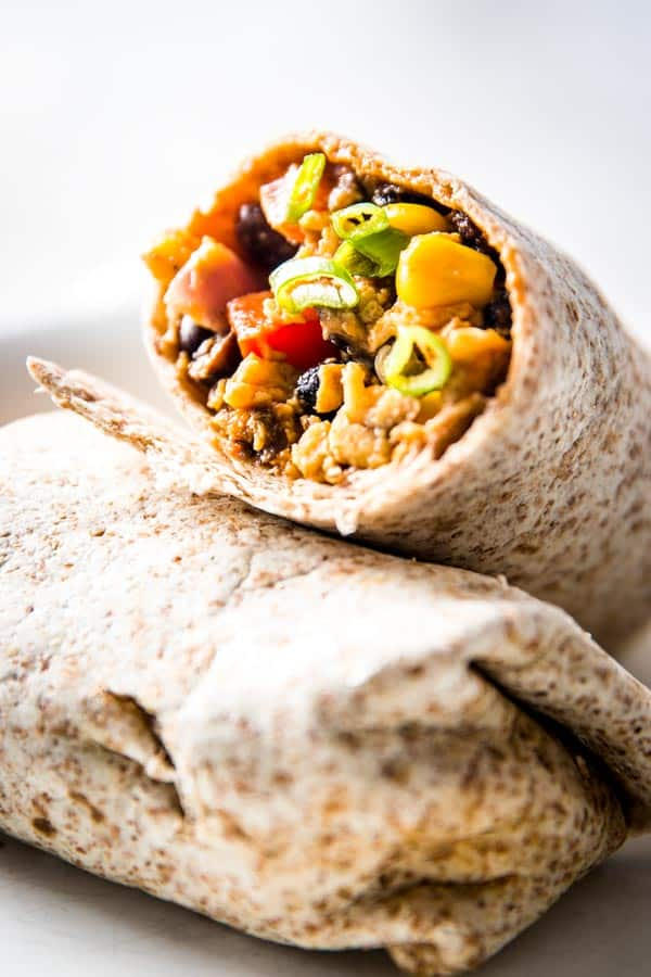 Southwestern flavors in these scrambled egg breakfast burritos make them irresistible! Stock your freezer today!