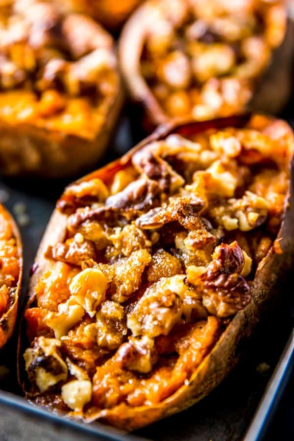 Take sweet potatoes to the next level with this recipe for twice baked sweet potatoes with maple and walnut topping. Perfect for football, as a fall party appetizer or even as a Thanksgiving side dish!