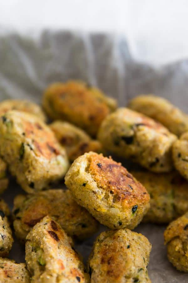 These homemade tater tots are made with mashed potato and shredded zucchini. Allergy friendly because they're egg free, dairy free, gluten free and vegan!