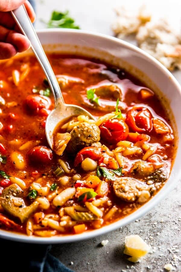 close up photo of crockpot soup with sausage and white beans