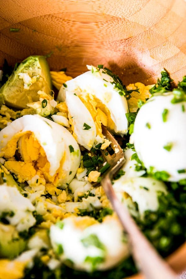 fork mashing eggs and avocado