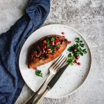 lentil stuffed sweet potato on white plate