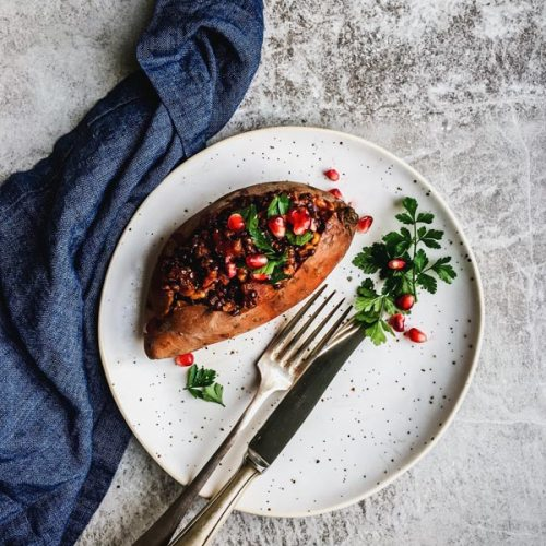 Hearty Lentil Walnut Stuffed Sweet Potatoes are a great vegan holiday dish. Try them for a healthy main!