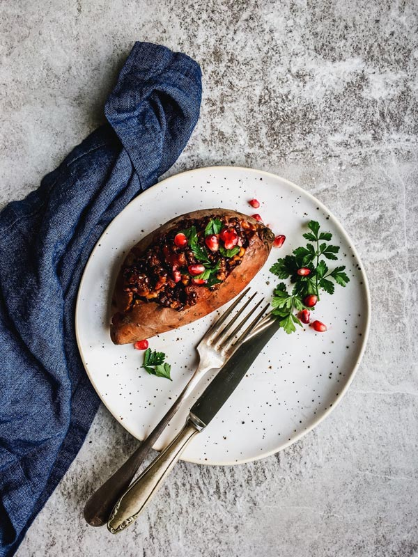 Hearty Lentil Walnut Vegan Stuffed Sweet Potatoes are a great vegan holiday dish. Try them for a healthy main!