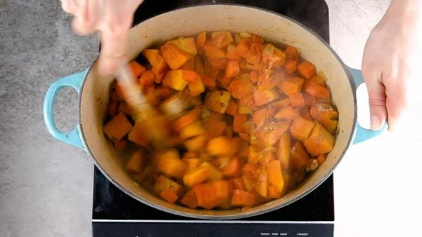 Roasting the vegetables and spices for easy pumpkin soup.