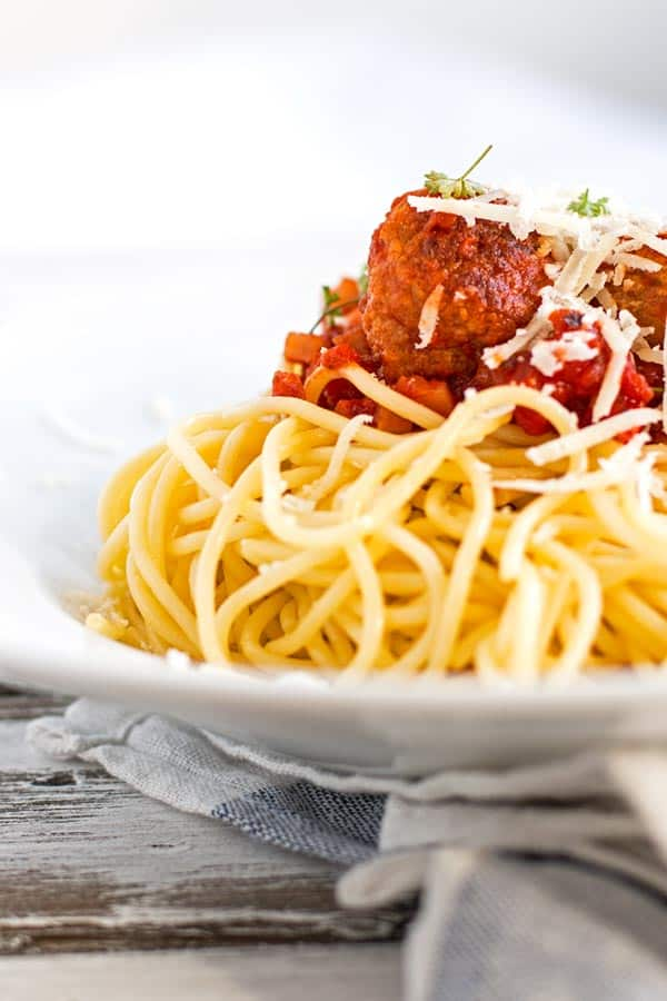 Homemade turkey meatballs in a smokey tomato sauce over spaghetti.