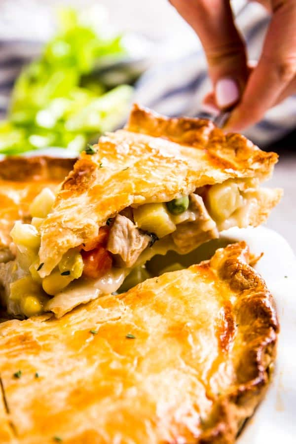 Lifting out a slice of homemade chicken pot pie.