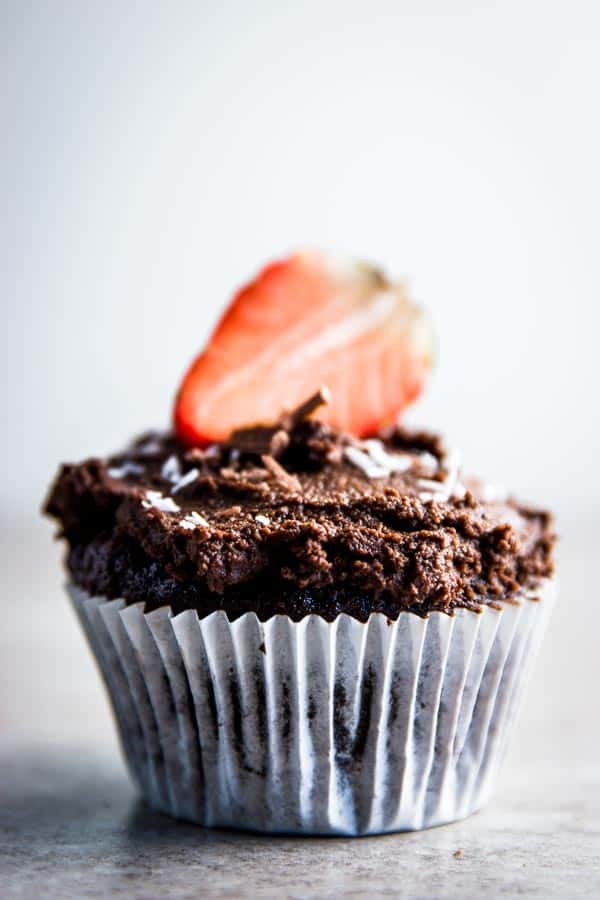 Easy chocolate cupcake with chocolate frosting and strawberry on top.