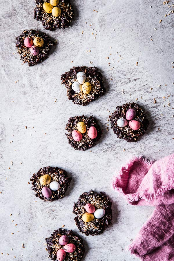 No Bake Bird's Nest Cookies on a grey countertop with a pink napkin.