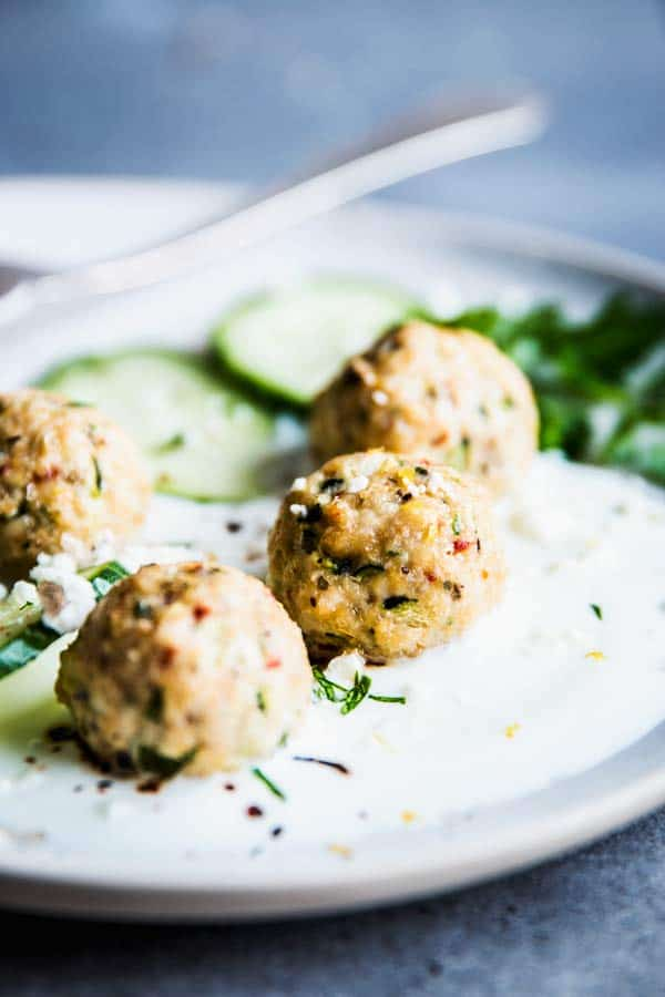 Close up photo of Greek Turkey Meatballs on a white plate.