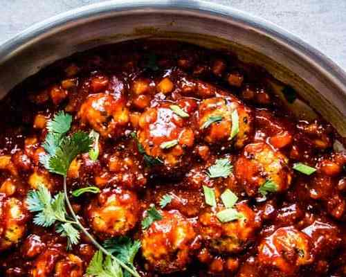 Pineapple BBQ Meatballs ina. stainless steel skillet.