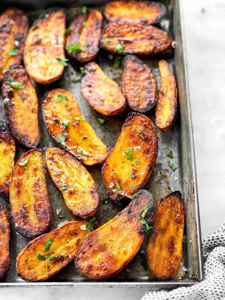 roasted fingerling potatoes on a metal pan
