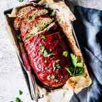 greek Turkey zucchini meatloaf sliced on a tray