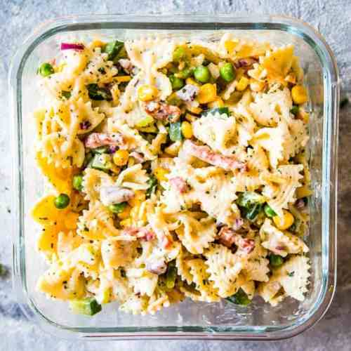 bacon ranch pasta salad in a glass container for a picnic