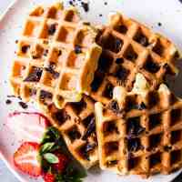 Chocolate Chip Waffles on a white plate.