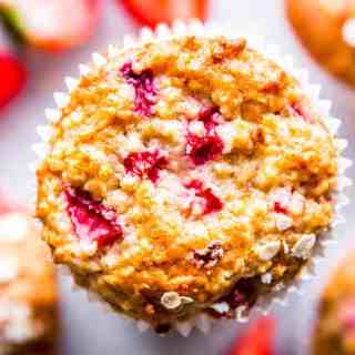 Strawberry Oatmeal Muffins stacked on the counter.