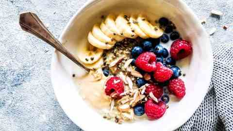 berry quinoa breakfast bowl in a white dish on the counter