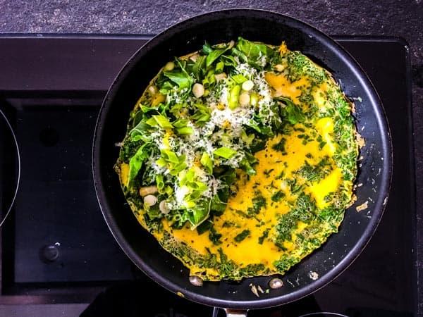 adding filling to a green goddess omelette