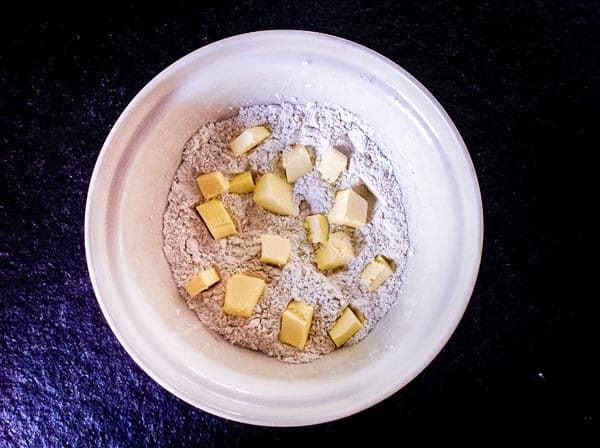 flour, salt and butter in a bowl to make pie crust