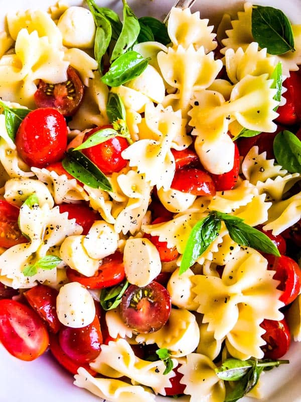 close up photo of caprese pasta salad