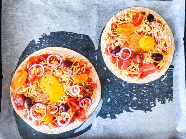 Tortillas with salsa, cheese, eggs and toppings