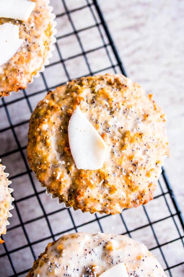 coconut lemon poppy seed muffins on a cooling rack