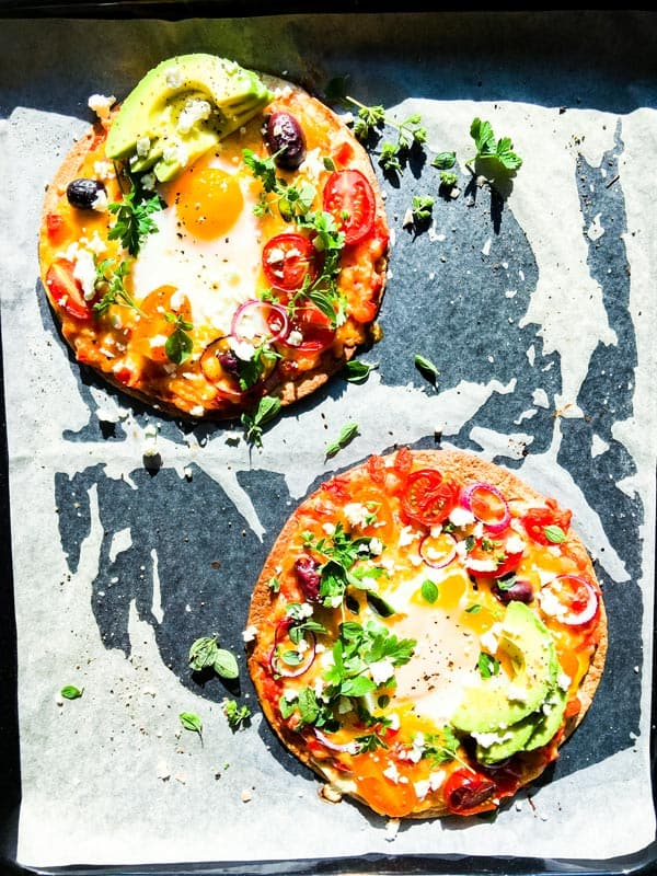 Mexican breakfast pizzas on a sheet pan