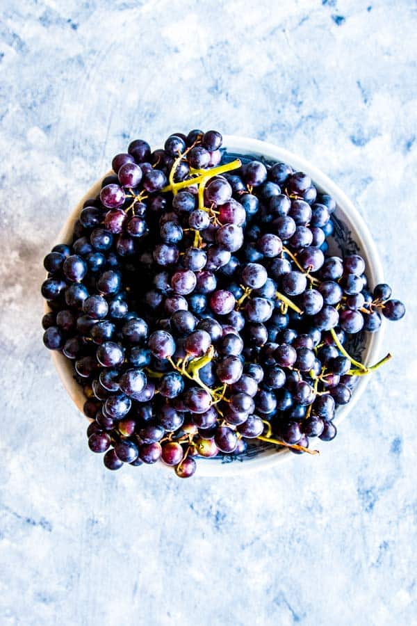 small blue grapes in a bowl