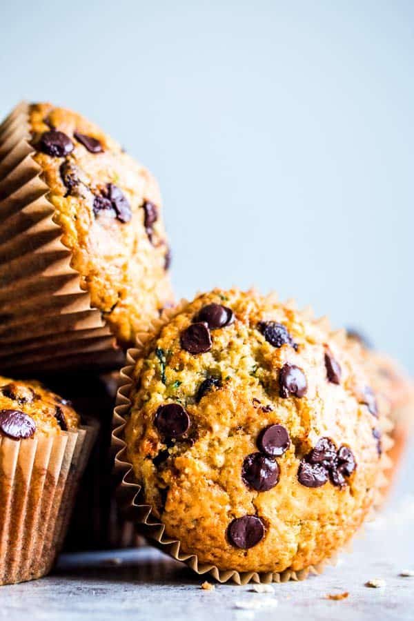a stack of chocolate chip zucchini muffins on the counter