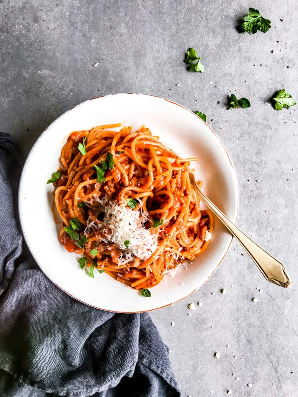 plate with spaghetti and meat sauce