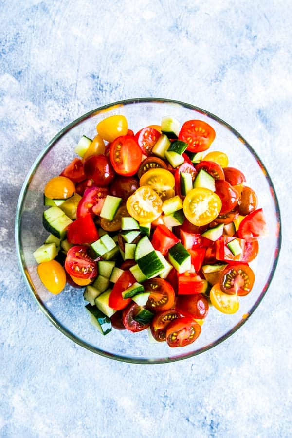 bowl of sliced tomatoes and cucumber