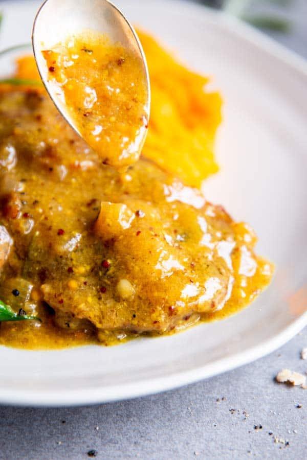 drizzling honey mustard sauce over instant pot pork chops