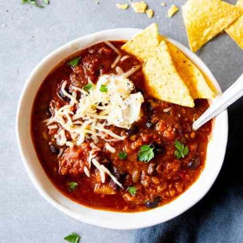 instant pot pumpkin chili in a white bowl