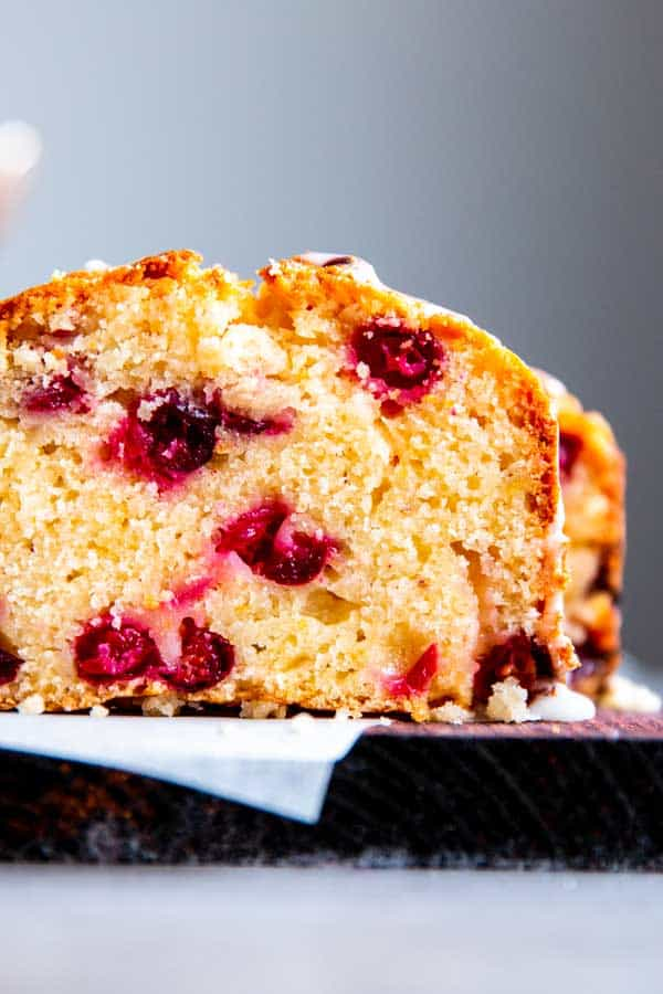 slice of cranberry orange bread with glaze