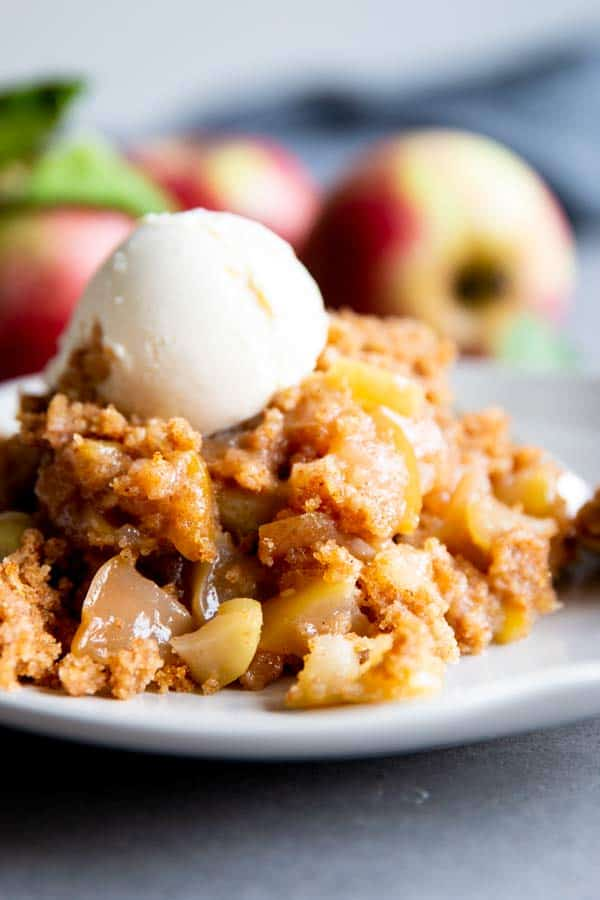 crockpot apple cobbler on a plate with ice cream