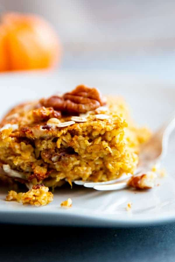 slice of pumpkin baked oatmeal on a white plate