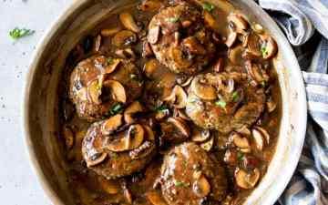 Salisbury steak in mushroom gravy in a skillet